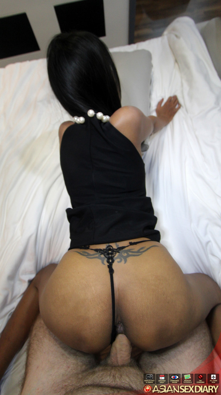 Thai girl with a shaved pussy removes her black dress before POV sex