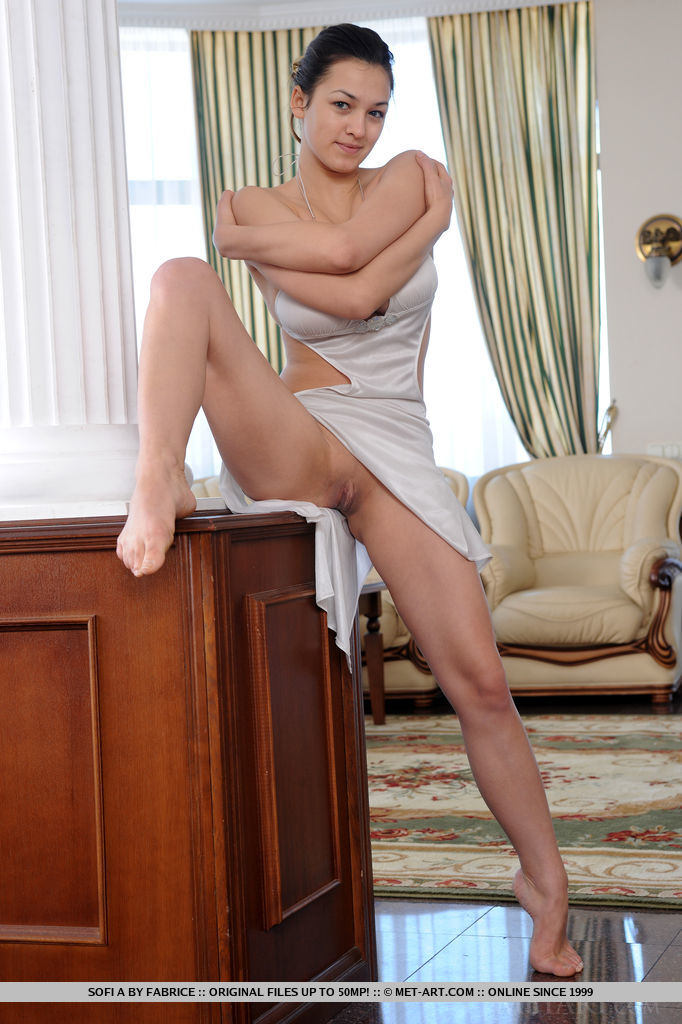 Acrobatic young girl Sofi A touting large juggs with legs wide open