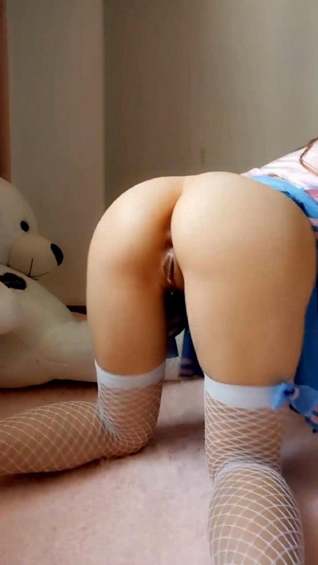 Asian girl playing with dildo